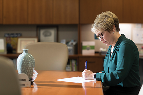 Ivy Tech President Sue Ellspermann working in her office