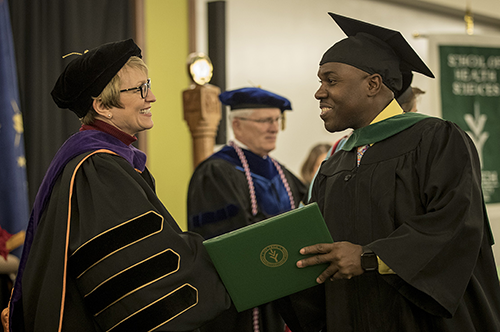 Ivy Tech President Sue Ellspermann congratulates a new graduate