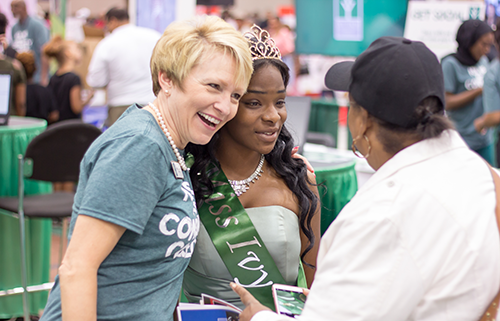 Ivy Tech President Sue Ellspermann with student at Indiana Black Expo